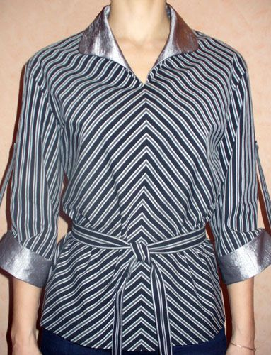 Blouse shirt cut from striped fabric