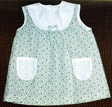 Dress at the yoke for a little girl learning how to cut and sew e-learning through online courses dressmaking sewing